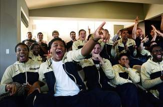 CU Buffs Tre'Shaun Fletcher, left,  George King, second from left, Ben Mills and other members of the CU Buffs men's basketball team react to being chosen to play Pittsburgh in the NCAA tournament while watching the results live in Boulder,  Co on March 16, 2014.  The entire team met at Coach Tad Boyle's house to see where they landed in the second round of the tournament.  The team earned the number 8 seed in the South Region of the 2014 NCAA Tournament. They will play Pittsburgh, the number 9 seed,  in a second round game Thursday, March 20 at the Amway Center in Orlando, Florida. (Photo By Helen H. Richardson/ The Denver Post)