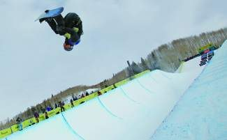 Shaun White gets inverted on his first run through the pipe during the Burton U.S. Open halfpipe semifinals at Golden Peak in Vail last March. White dominated the competition to earn a gold medal. The event returns to the slopes of Vail again this March.