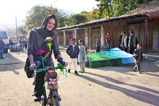 Breckenridge resident Shannon Galpin bikes with a young girl in Afghanistan. Galpin nonprofit, Mountain2Mountain, helps Afghani women face domestic violence and women's rights issues through in-country cycling events.