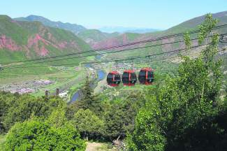 The Glenwood Caverns Adventure Park gondola takes guests high, high above Glenwood Springs and the nearby red rock canyons. Once at the top, there's a roller coaster, amusement rides and high-adventure cave tours.