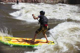 A SUP paddler maneuvers into position at the Glenwood Springs kayak park, found just minutes from downtown Glenwood. Surfing on a SUP board is different than surfing in a kayak or even an ocean surfboard thanks to rapid flows and a static wave.