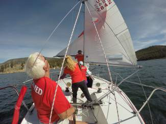 A J22 crew practices rigging the main sail and reading the wind on Lake Dillon in early July.