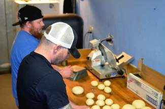 Erik Carpenter, foreground, and Gavin Lewis prepare dough in the kitchen at Jonny-G's in Frisco. Jonny-G's will close its doors forever on Wednesday, April 30, with its final Ladies Night. Ladies Night was the first promotion owner Jonny Greco ever did at Jonny-G's, so it's fitting that it's also his last. The fun starts at 9 p.m., there's no cover, and Greco said he has some surprises in the works for closing night.