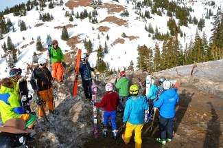 Just before dropping in on a last run halfway up Loveland Pass, these backcountry skiers pause in remembrance of the five people killed near this spot on Sheep Creek last year on April 20, which became the deadliest avalanche for Colorado in more than 50 years. The skiers were part of the 13th annual Corn Harvest, a benefit for the Colorado Avalanche Information Center (CAIC), held at nearby Loveland Ski Area, which had several hundred backcountry enthusiasts attending and raising thousands of dollars for the CAIC. Loveland Ski Area officially closes on Sunday, May 4. Visit www.skiloveland.com for more information.