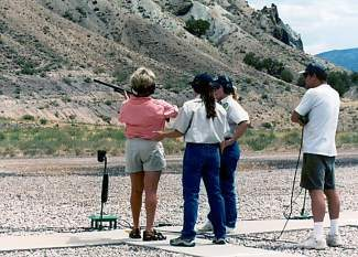 Shooting and hunting instructors Joni Bedell and Emily Curry (center) with Colorado Parks and Wildlife give instruction at a CPW program last summer.