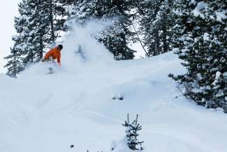 A snowboarder gets ready to drop into the deep stuff on a 12-inch powder day at Breckenridge Dec. 23.