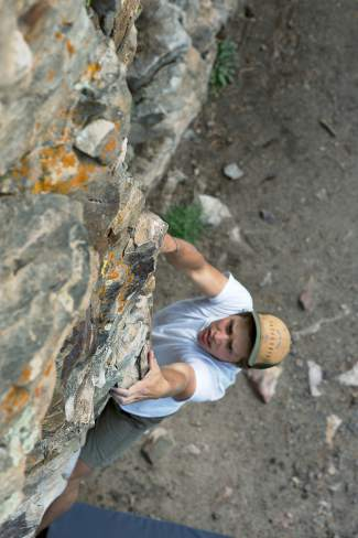 Summit County native Sage Miller eyes a hold on Swan Mountain Wall, a popular bouldering area between Breckenridge and Keystone on Swan Mountain Road.