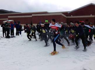 Runners charge off the starting line at last year's Colorado Cup snowshoe race. The race returns Saturday with 2K 5K and 10K courses.
