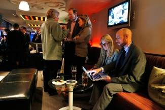 Brian Vicente, chairman of the Yes on Prop. AA campaign, right, and campaign staffer Christie Nima, look at vote returns on a laptop during an election party for those in favor of Proposition AA, to impose specific taxes on recreational marijuana use, at a hotel bar in Denver, Tuesday Nov. 5, 2013. Voters in Colorado went to the polls Tuesday to decide on how much tax, if any, to levy on the state's soon-to-be-legal recreational marijuana sales (AP Photo/Brennan Linsley)