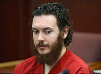 FILE -This June 4, 2013 file photo shows Aurora theater shooting suspect James Holmes in court in Centennial, Colo. Prosecutors and defense attorneys in the Colorado theater shooting case are battling over what evidence can be admitted during Holmes' murder trial, all in an attempt to build up or tear down the case that he was insane. On Thursday, Oct. 17, 2013 they are scheduled to argue over statements Holmes made to police after he was arrested after the July 2012 shootings and taken to a police station. (AP Photo/The Denver Post, Andy Cross, Pool, File)