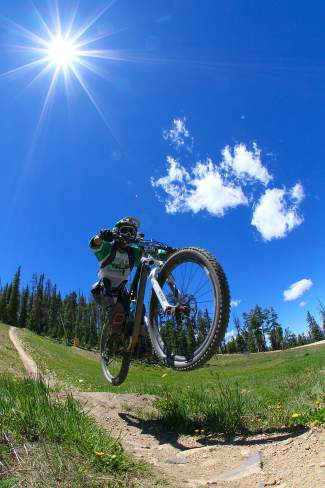 A cyclist barrels through bumps in the sunshine at Keystone Resort during the Big Mountain Enduro race on July 12