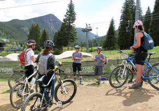 A group of women listen to instructors at a 2014 women's-only MTB clinic with the VIDA series in Keystone. VIDA instructor Sarah Rawley leads a beginner-friendly clinic at the Silverthorne Recreation Center on June 7, with info on basics like braking, bunny hops and more.