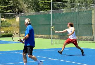 Players in the Keystone Wood Racquet Open volley during doubles-only play with an old-school twist: everyone used wooden racquet for at least two games.