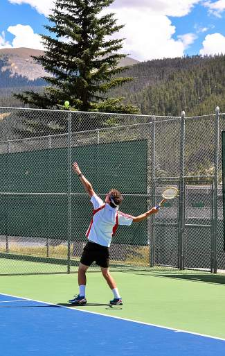 A player gets ready to serve at the first-annual Keystone Wood Racquet Open on Aug. 15 at the Keystone Tennis Center.