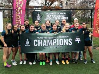 The Atlantis U-18 girl's rugby team after winning the Championship Cup at the New York Sevens Rugby Tournament on Thanksgiving weekend, an annual tourney hosted outside of Manhattan. The team included four Summit Tigers: Cassidy Bargel, Jody Losch, Natalie Gray and Meg Rose.