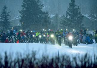 Nearly 60 riders with headlamps take off from the start line for the men's open race at Ullr Bike at the Gold Run Nordic Center on Jan. 15.