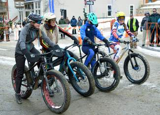 Competitors in the women's field at the Fat Bike Eliminator line up for the start of a fat-bike race through downtown Breckenridge on Jan. 14 before the Ullr Parade.