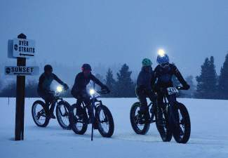 The four-person women's field rounds the first corner at the Ullr Bike at Gold Run Nordic Center on Jan. 15.