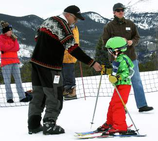 Frisco Mayor Gary Wilkinson awards bubble gum to a young ski racer at the finale of the Bubble Gum Race Series at the Frisco Adventure Park on March 25.