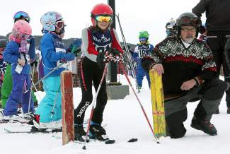 Skiers watch their competition with Frisco Mayor Gary Wilkinson at the start line of the final Bubble Gum ski race at the Frisco Adventure Park on March 25.