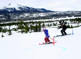Back in the boots: Frisco Mayor Gary Wilkinson, a veteran of the local ski club scene, charges gates with a young competitor during the final parallel slalom of the Frisco Bubble Gum Race Series on March 25 at the Frisco Adventure Park.