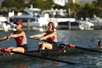 Summit County local Ellie Hartman (right) during training with the Barry University eight-person rowing team. Hartman led her crew to its second Division II NCAA National Championship last weekend in California.