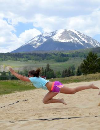 Christina Koetteritz dives for the ball during an intense rally in the final game of the first Princess of the Beach sand volleyball tournament, hosted at the Silverthorne rec center sand courts on June 17.