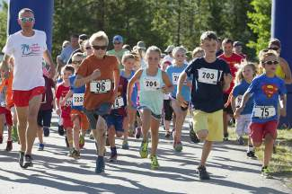 Young runners take off from the start line during a Mountain Goat Kids trail race in Frisco last year. The series returns this July with one race every Tuesday at the Frisco Peninsula.