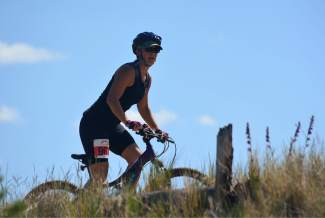 A mountain biker rides along a ridge at Frisco Peninsula during the 2016 Frisco Triathlon on July 16.