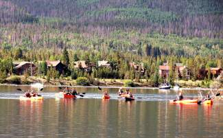 National Reperatory Orchestra members take to Lake Dillon in kayaks and rowboats this July during an annual visit to the Frisco Rowing Center between performances in the Rocky Mountains.