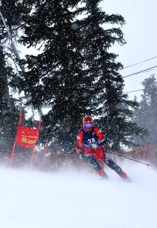 A racer rounds a gate in the snow during a Copper Business League race series giant slalom on the Copperopolis course Feb. 18. The race began at 10 a.m. in blowing snow and ended with a bit of calm sunshine just an hour later.