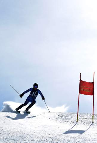 The sun begins to peek out from behind a racer on the Copperopolis course at the Copper Business League race series giant slalom Feb. 18.