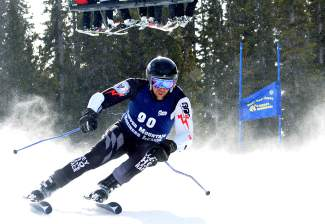 A racer weaves through gates on a powdery course during the Copper Business League race series giant slalom Feb. 18.