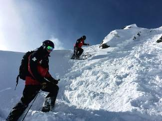 Ski patrollers pack snow on western Union Ridge at Copper Mountain, one of dozens of jobs the Copper patrol oversees.
