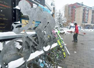 Summer to winter: Skiers walk past the USA Pro Challenge bike rack in Center Village at Copper Mountain on opening day Nov. 11.