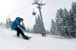 Breckenridge local Evan Hannibal cruises down the middle section of Main Vein on opening day at Copper Mountain Nov. 11. Skiers and snowboarders were greeted by 7 inches of fresh snow from a fast-moving storm.