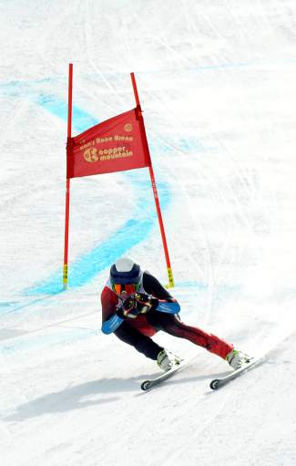 A skier tucks through the final straightaway on the super-G course at the 2016 USSA U-19 Junior Championships at Copper.