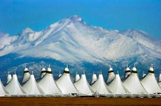 DENVER, COLORADO--FEBRUARY 17, 2005--The tent-like cover on the main terminal of Denver International Airport  - DIA -  rises from farmland as viewed from the point east of the airport.  In the 10 years since its opening, growth has occurred on the other three sides of what was once considered open farm fields.   (PHOTO BY GLENN ASAKAWA/DENVER POST STAFF)