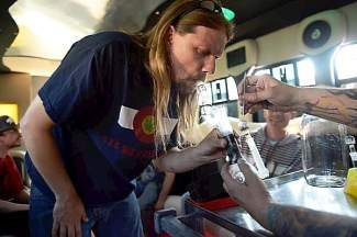 """DENVER, CO. - APRIL 26: Chris Jetter, owner of Blue Mountains, """"the original rocky mountain high"""" in the Blue Mountains dab bus for a free happy hour dab bar downtown April 26, 2013 Denver, Colorado. (Photo By Joe Amon/The Denver Post)"""