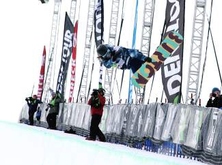 Kelly Clark airs out of the halfpipe during a victory lap at the 2014 Dew Tour. Clark, a veteran with multile halfpipe victories at Dew Tour and the Olympics, is a pro at hitting all five criteria that competition judges want to see.