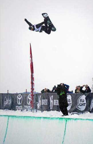 Shaun White airs out of the halfpipe on his winning run during the Dew Tour men's snowboard superpipe competition at Breckenridge Ski Resort Saturday.