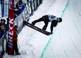 Shaun White tweaks out a switch nose grab during his second run of the men's Dew Tour snowboard halfpipe finals on Dec. 12. White won with a score of 92.60.