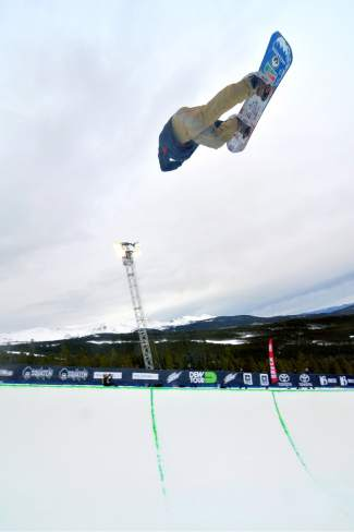 Danny Davis tweaks a nose grab through an invert during practice before the men's halfpipe semifinal at the 2015 Dew Tour.