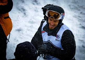 Shaun White smiles for the cameras after taking first place at the men's Dew Tour snowboard halfpipe final on Dec. 12. White, who has competed in only a handful of competitions since taking fourth at the Sochi Olympics, put on a show in the snowstorm.