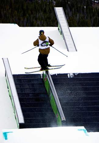 A skier takes a run during the Dew Tour men's slopestyle semifinals at Breckenridge Ski Resort on Dec. 10. The finals begin at 11:30 a.m. on Dec. 13.