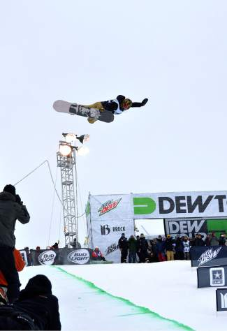 Danny Davis lofts a signature switch method on the first hit of his first run at the men's snowboard superpipe semifinals for Dew Tour at Breckenridge on Dec. 10. Davis, a former champ at Breck, missed the finals with three falls in three runs.