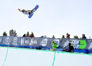 Ben Ferguson of Oregon holds a tweaked-out method grab during the first run of the men's snowboard superpipe semifinals for Dew Tour at Breckenridge on Dec. 10. Ferguson edged into the final with a stellar second run.
