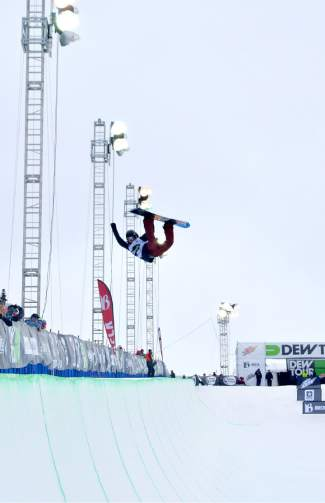 A snowboarder lofts a mean method on his final hit of the men's snowboard superpipe semifinals for the Dew Tour in Breckenridge on Dec. 10.