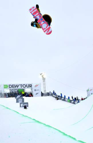 Jake Pates of Eagle throws a single 1080 during the first run of the men's snowboard halfpipe semifinal at Dew Tour in Breckenridge on Dec. 10. The final takes place Dec. 12 at 12:30 p.m.