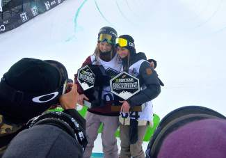 Cassie Sharpe (left) and Brita Sigourney (right) pose for photos after taking second and third, respectively, in the women's freeski superpipe final at Dew Tour in Breckenridge on Dec. 11.